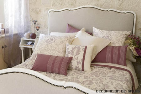 cama muchos cojines