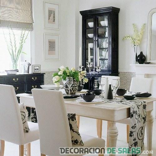 comedor blanco con manteles en negro