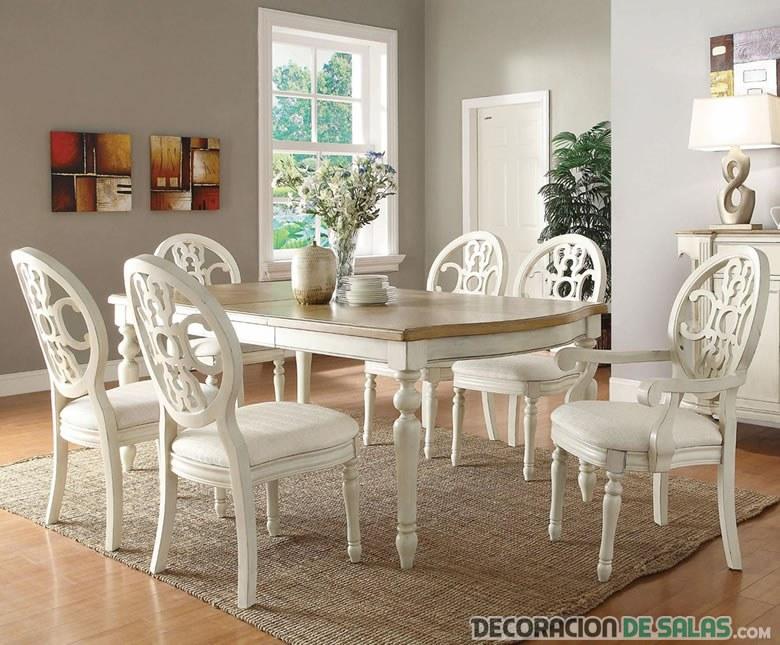 comedor con sillas blancas clásicas