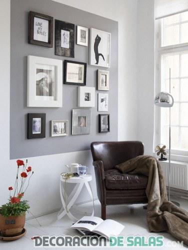 decoración rincón con sofá y cuadros