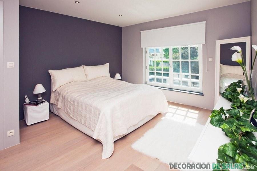 dormitorio de matrimonio con pared en gris