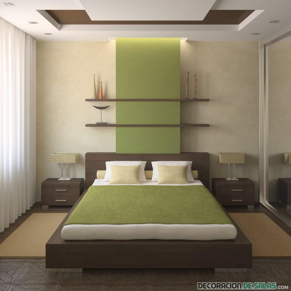 habitación pequeña en verde con cabecero