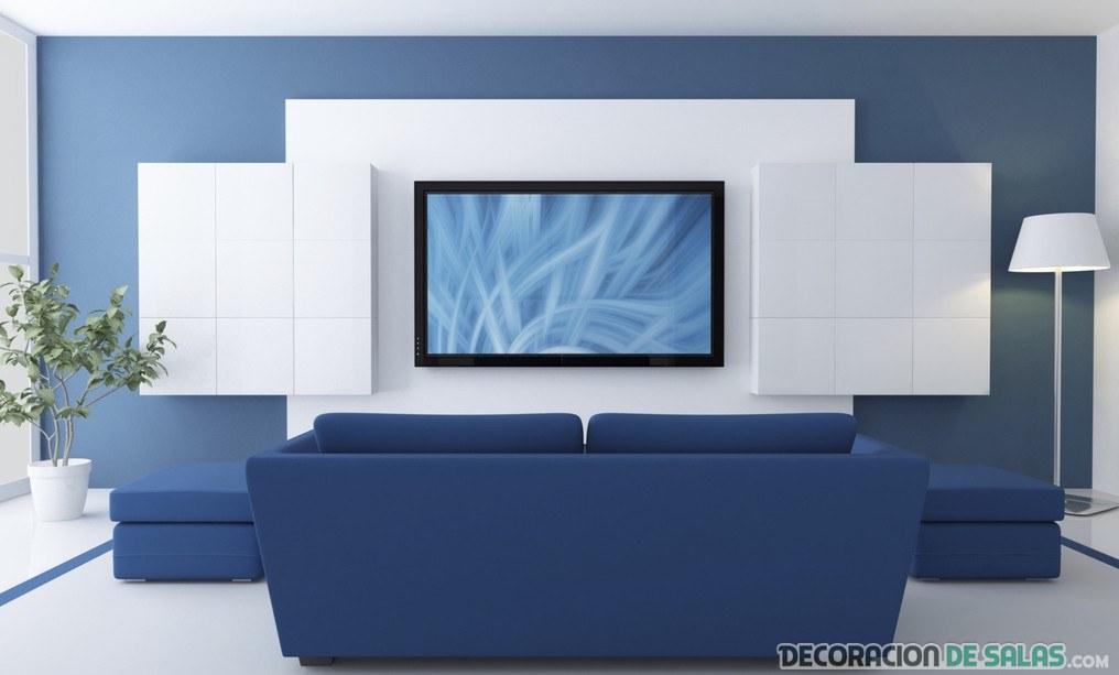 salón con pared blanco y sofá azul