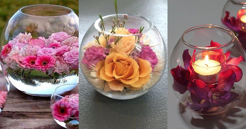 pecera y flores naranjas y rosas