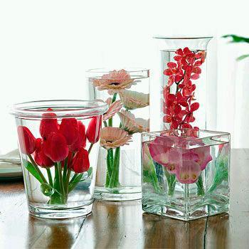 plantas y flores rojas centro de mesa