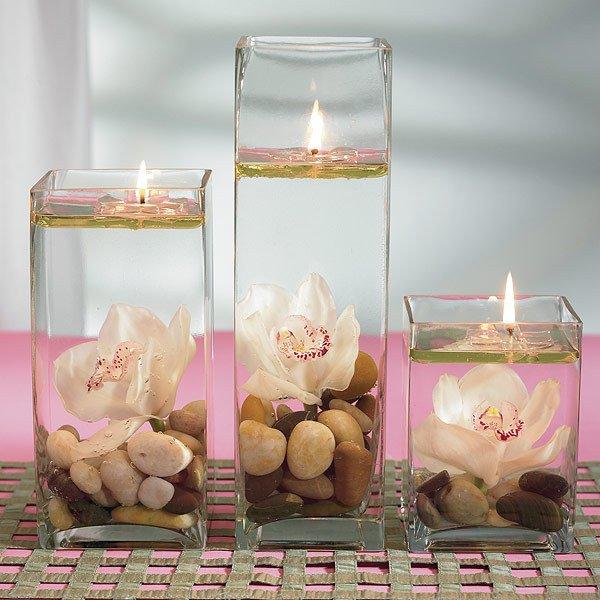Centro de mesa velas y flores