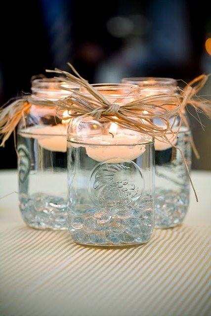 velas flotantes en tarros